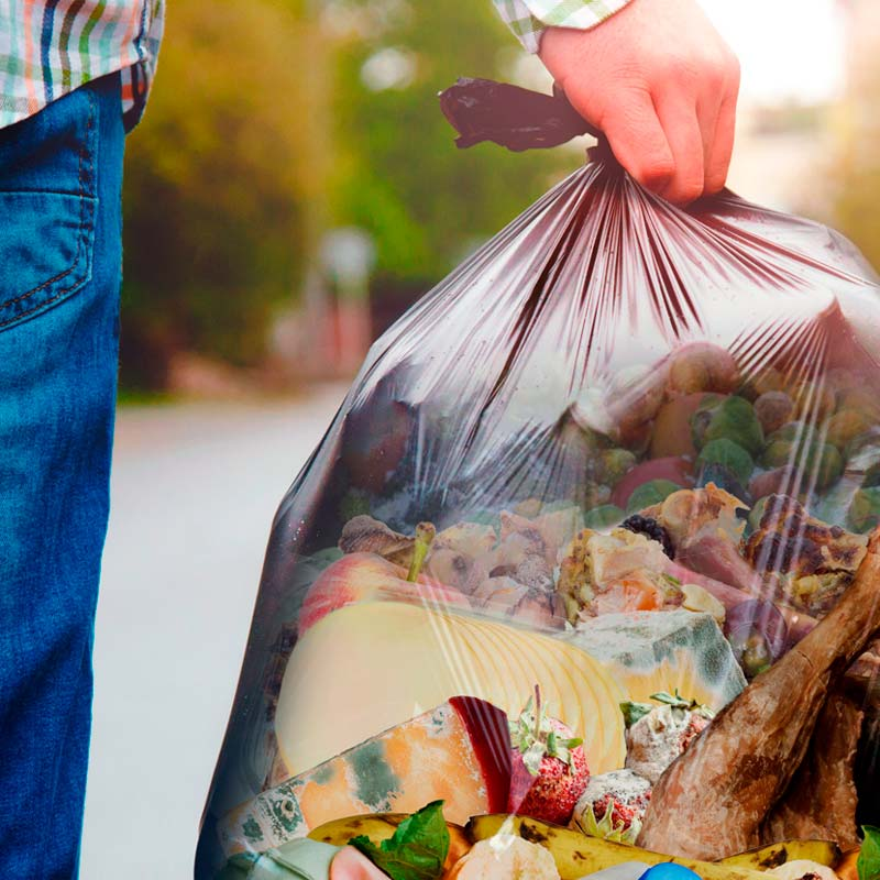 Man with a food waste bag